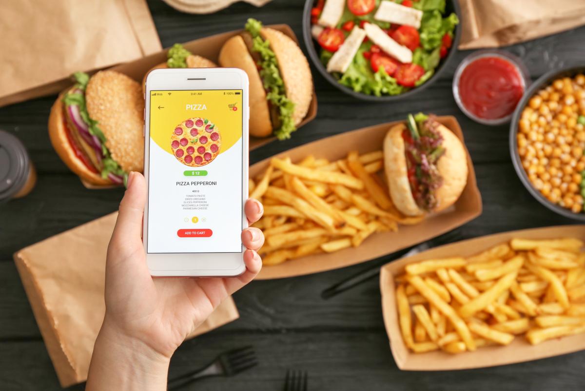 Mobile food ordering choosing pizza