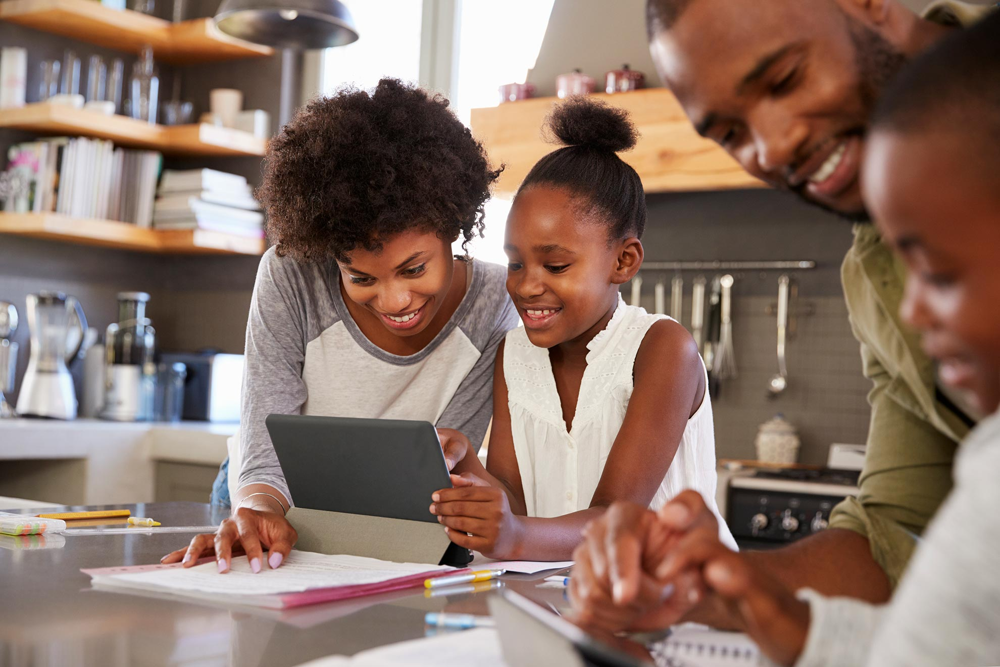 A family completes classwork together at home