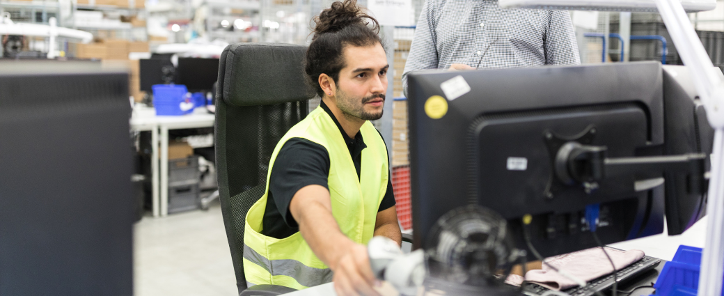 Warehouse worker reviewing CSAT scores during holiday season