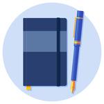 A notebook next to a pen