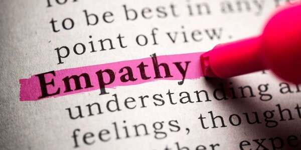 The word 'empathy' being highlighted in a dictionary.