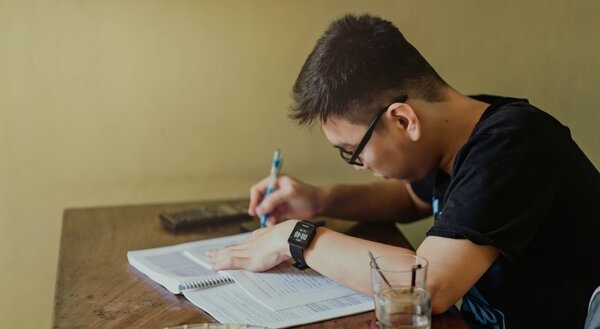 A medical student studying hard on a desk