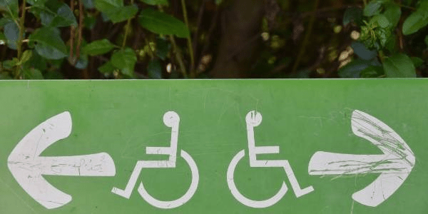 A green sign showing disabled access