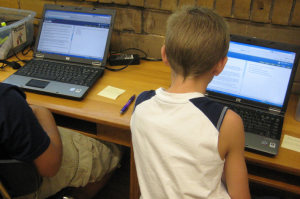 students operating their laptops