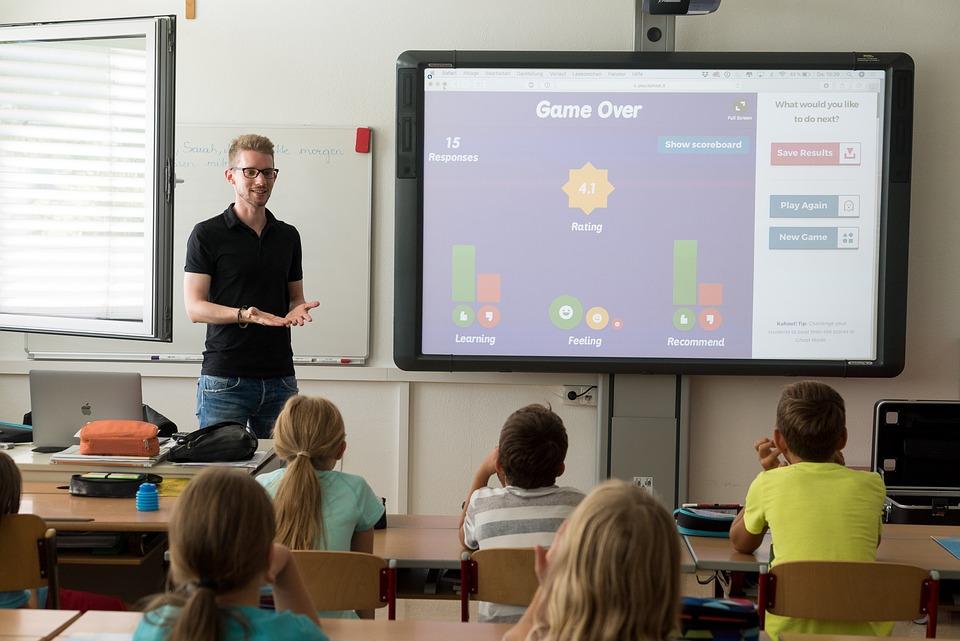Teacher in the classroom using a smart board