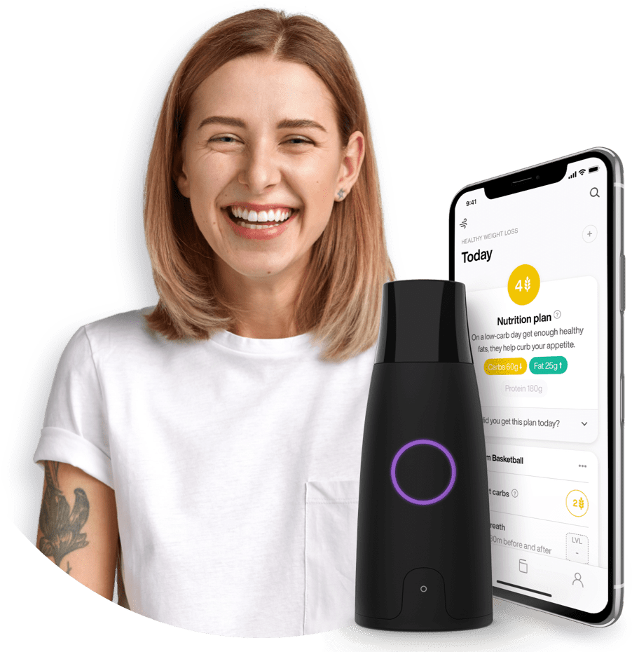 A young woman smiling with a preview of the Lumen device.