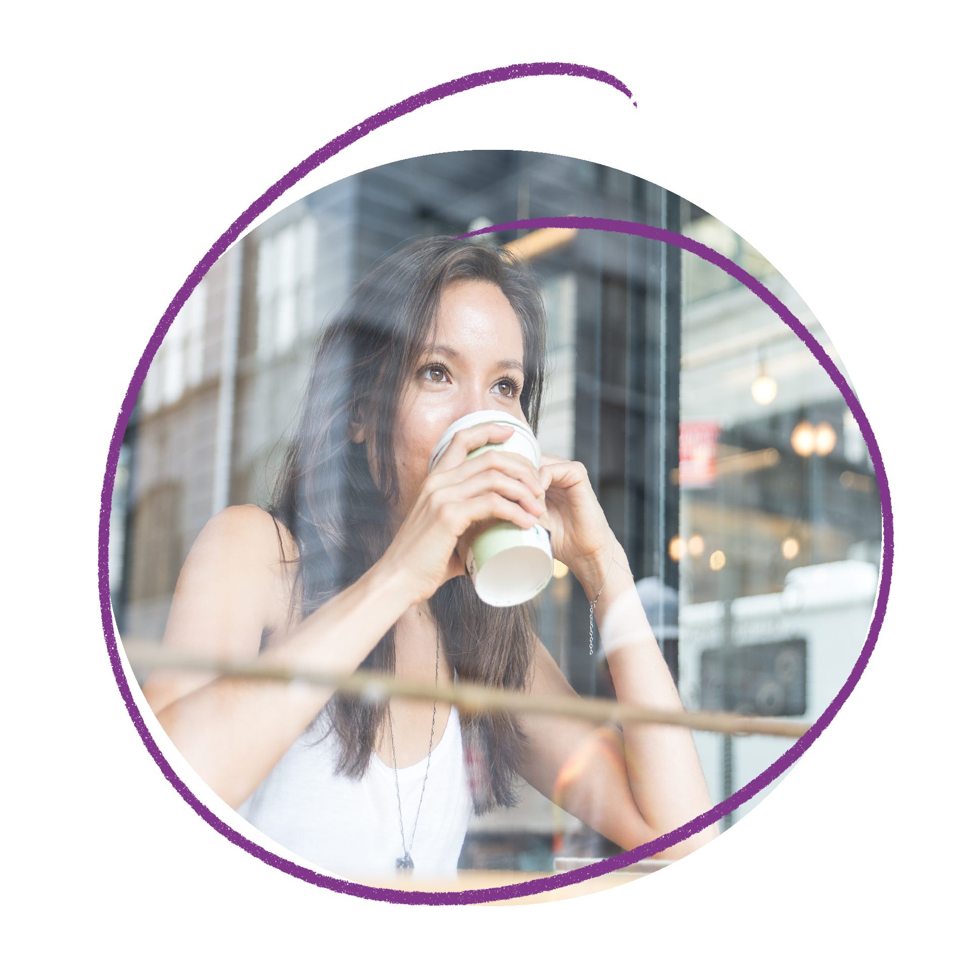 Photo of a woman looking out a window drinking coffee out of a take away cup.