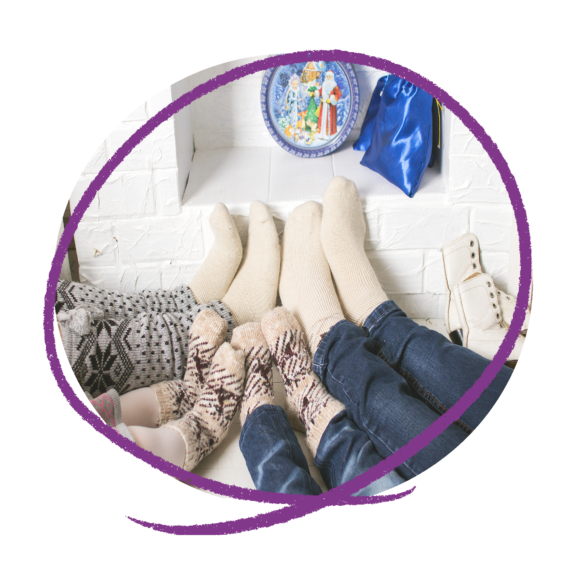 Photo of the feet of a family of four wearing thick socks. Two adults and two children.