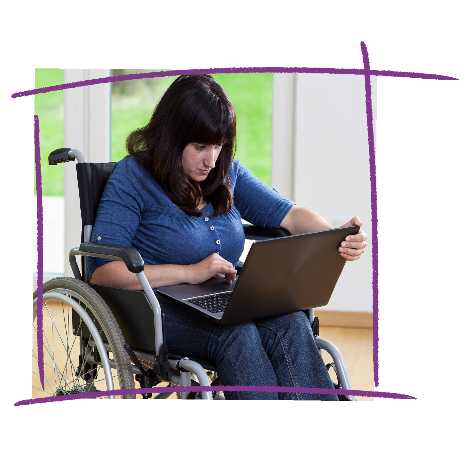 Photo of a woman in a wheelchair reading on a laptop.