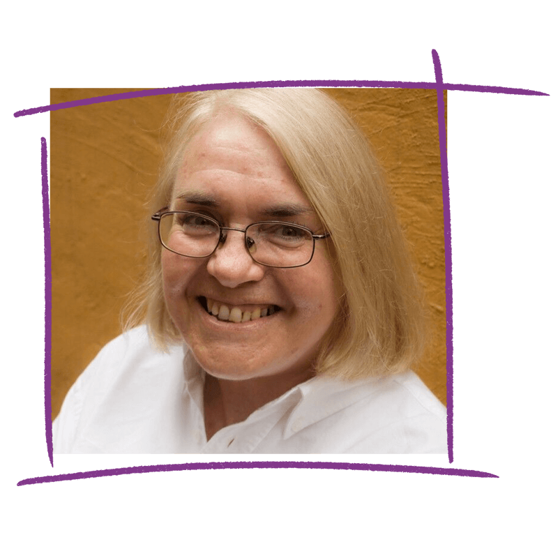Photo of WWDA Board member, Pamela; an older woman with blonde hair and glasses.