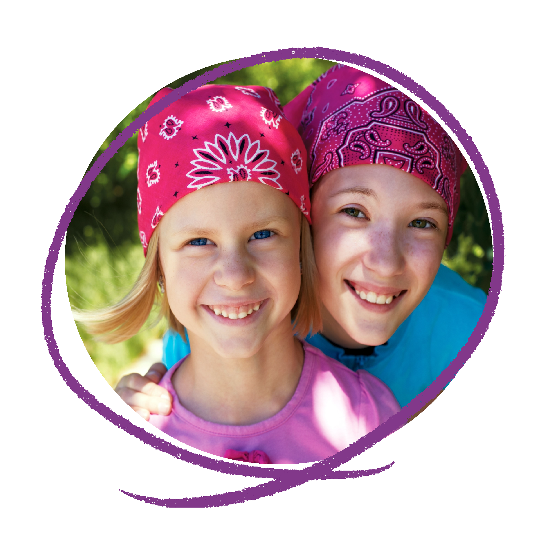 Photo of two young girls with pink bandana's on smiling.