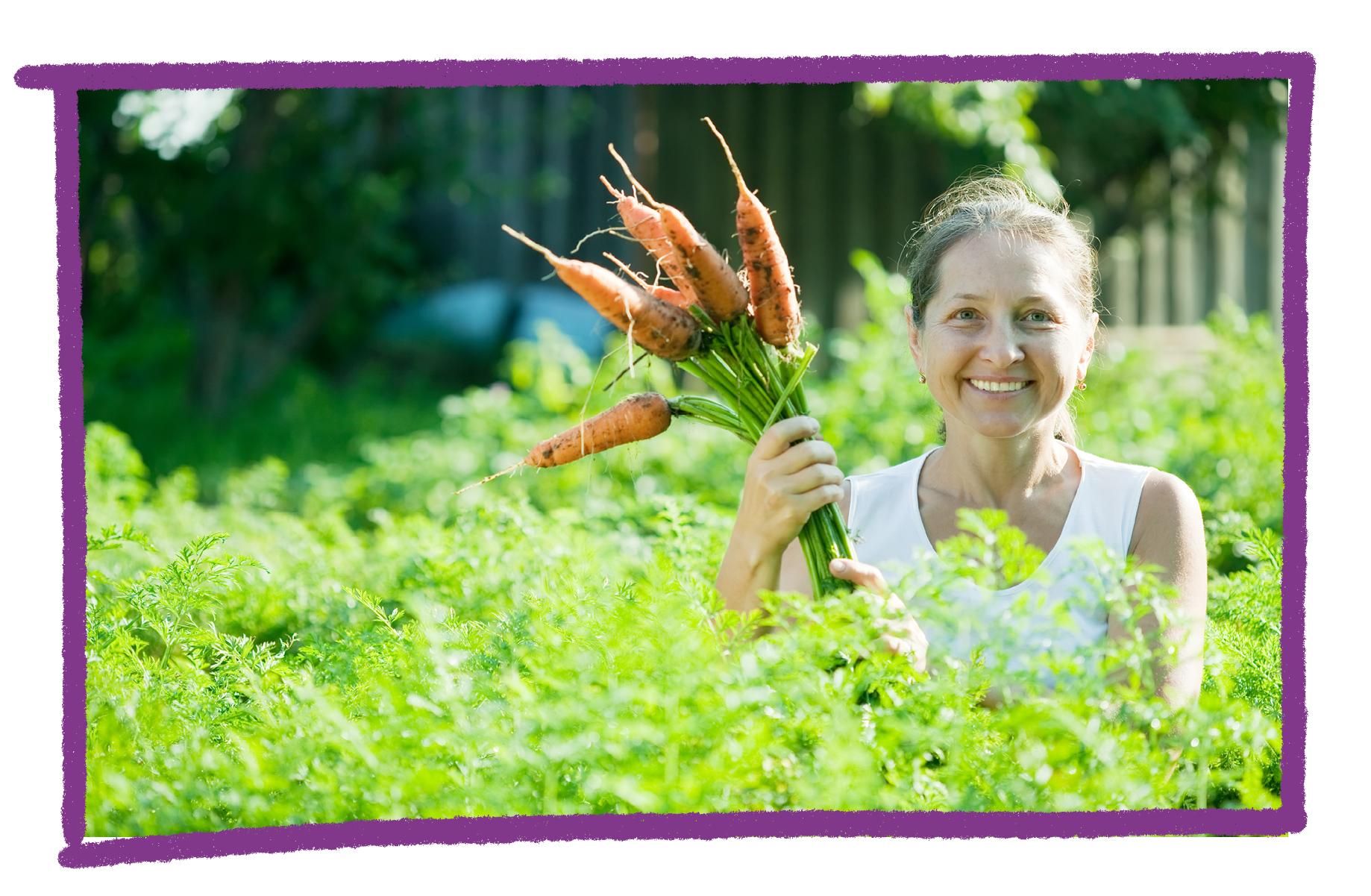 Photo of a woman holding a bunch of carrots