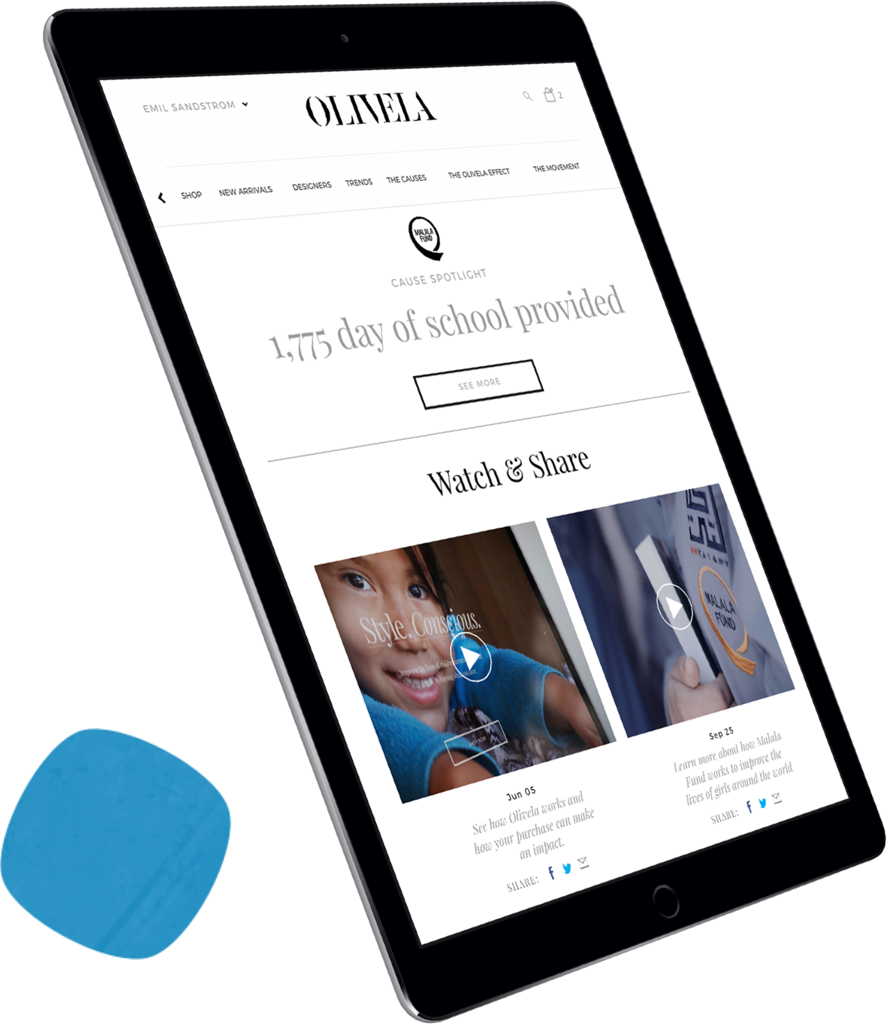 A tablet with the Olivela front page displayed on it.