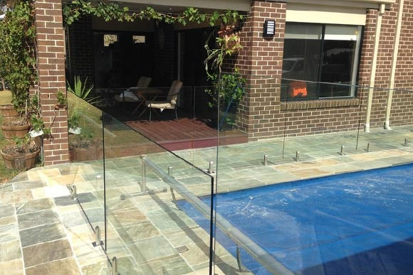 Outdoor courtyard with safety glass fencing