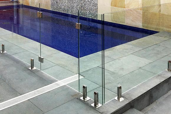 Glass pool gate and fence around outdoor patio
