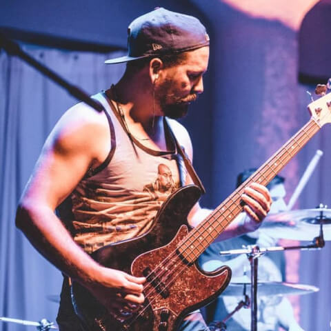 Play bass in a metal band