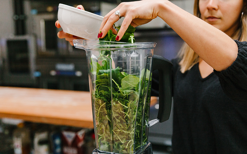 Thistle's nicoise salad recipe starts by adding all of the greens together in a blender or food processor.