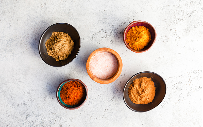 Pantry staples that are necessary in adding flavor to any meal include spices and dried herbs.