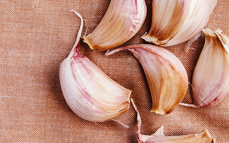 Garlic, one of many detox foods, directly supports liver enzymes that help pump toxins out of the body.