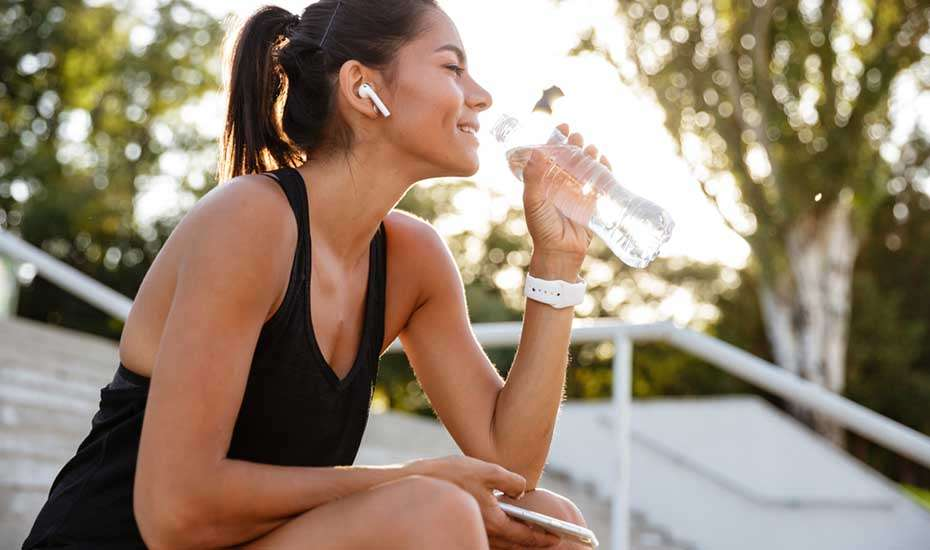 Woman using water hydration app