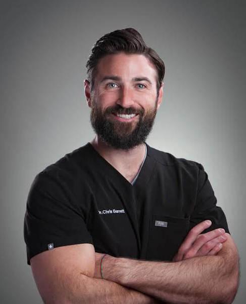 Portrait of Dr. Chris Barrett who focuses on dental implants.