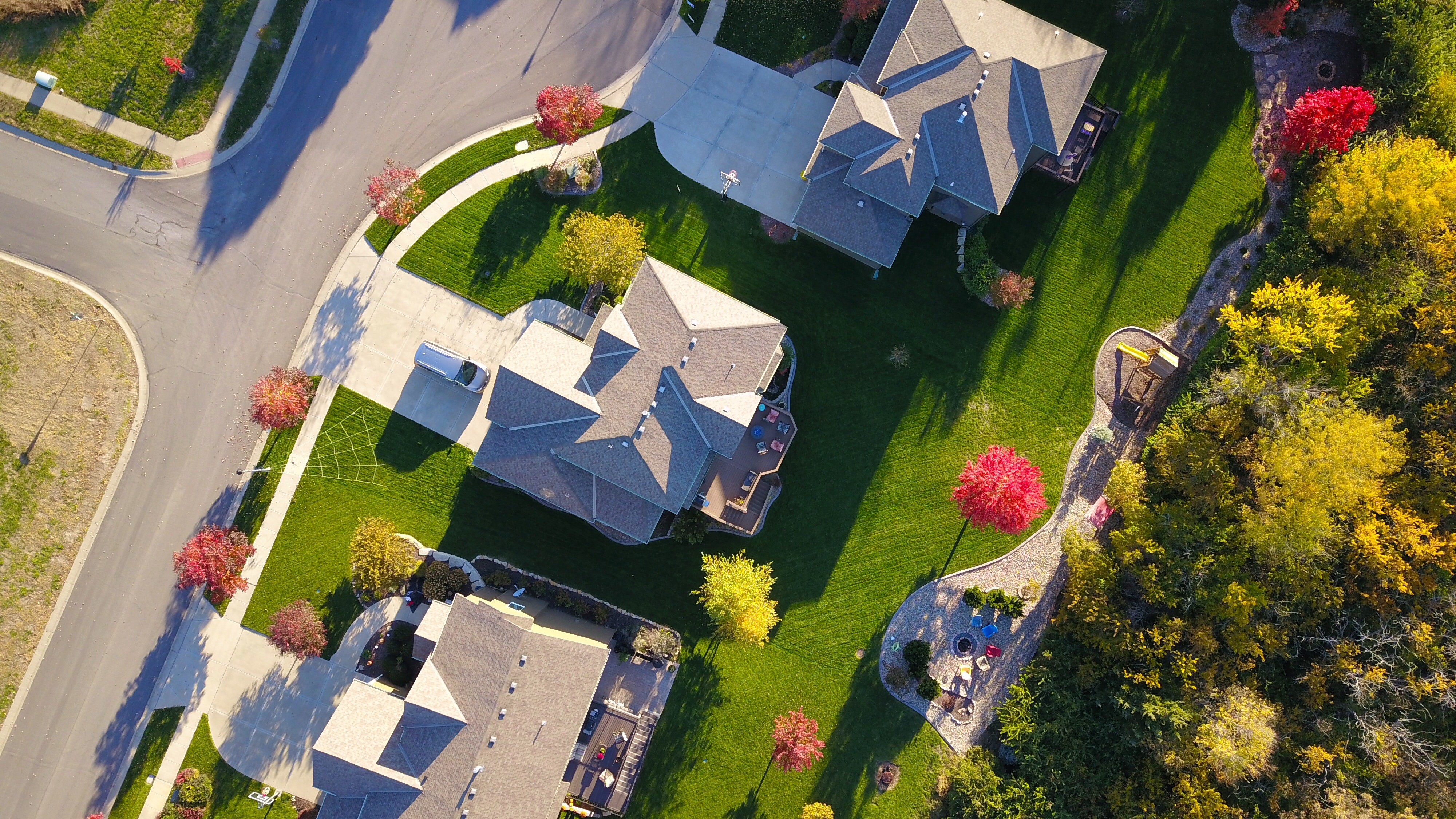 Drone view of rooftops to support how Rake helps roofing companies
