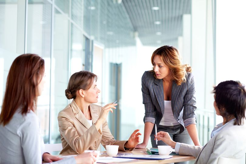4 female business associates