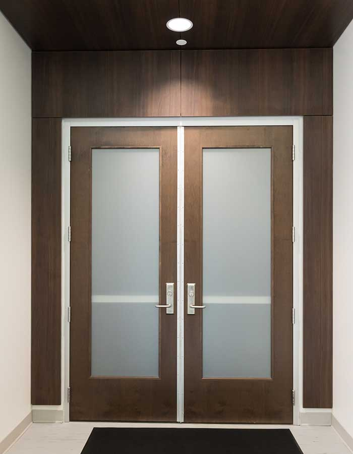 Brown wooden doors located in the LSU Rec