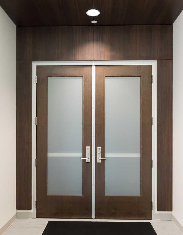 Brown wooden doors located in the LSU Rec