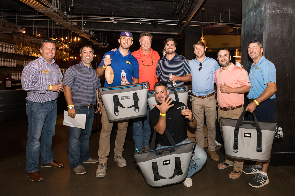 Group of Himmel employees showing off Yeti coolers that they won from the Bowling Tournament