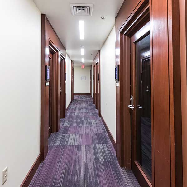 Hallway showing wooden and glass doors in LSU Patrick Taylor Hall