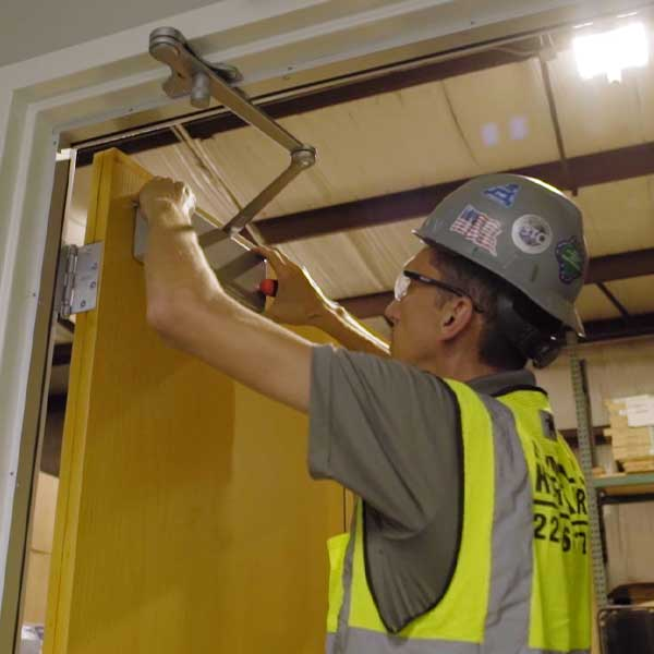 Alex, employee at Himmel's, installing a door.