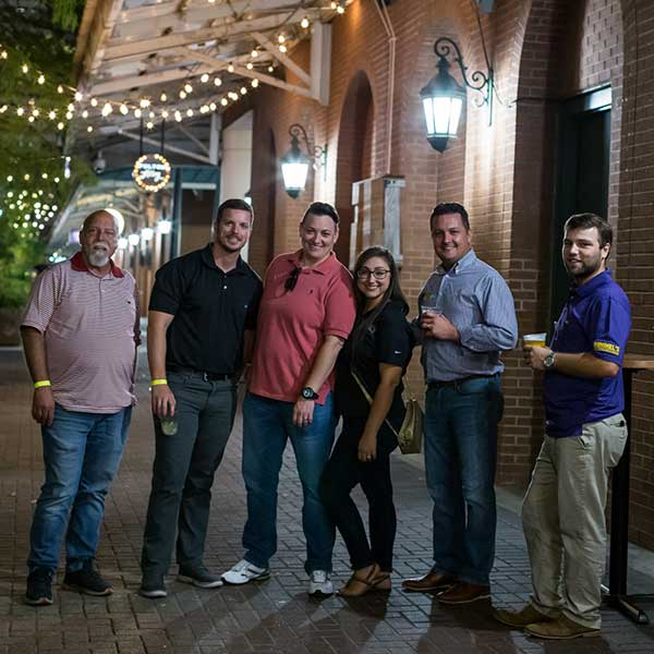 Group of Himmel employees outside of Fulton Alley in New Orleans
