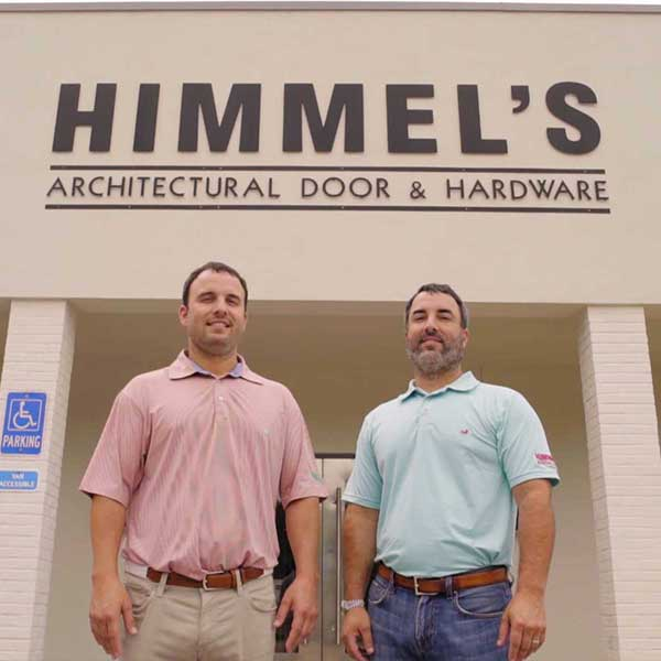 Jay and Chad Himmel in front of the Prairieville Himmel building