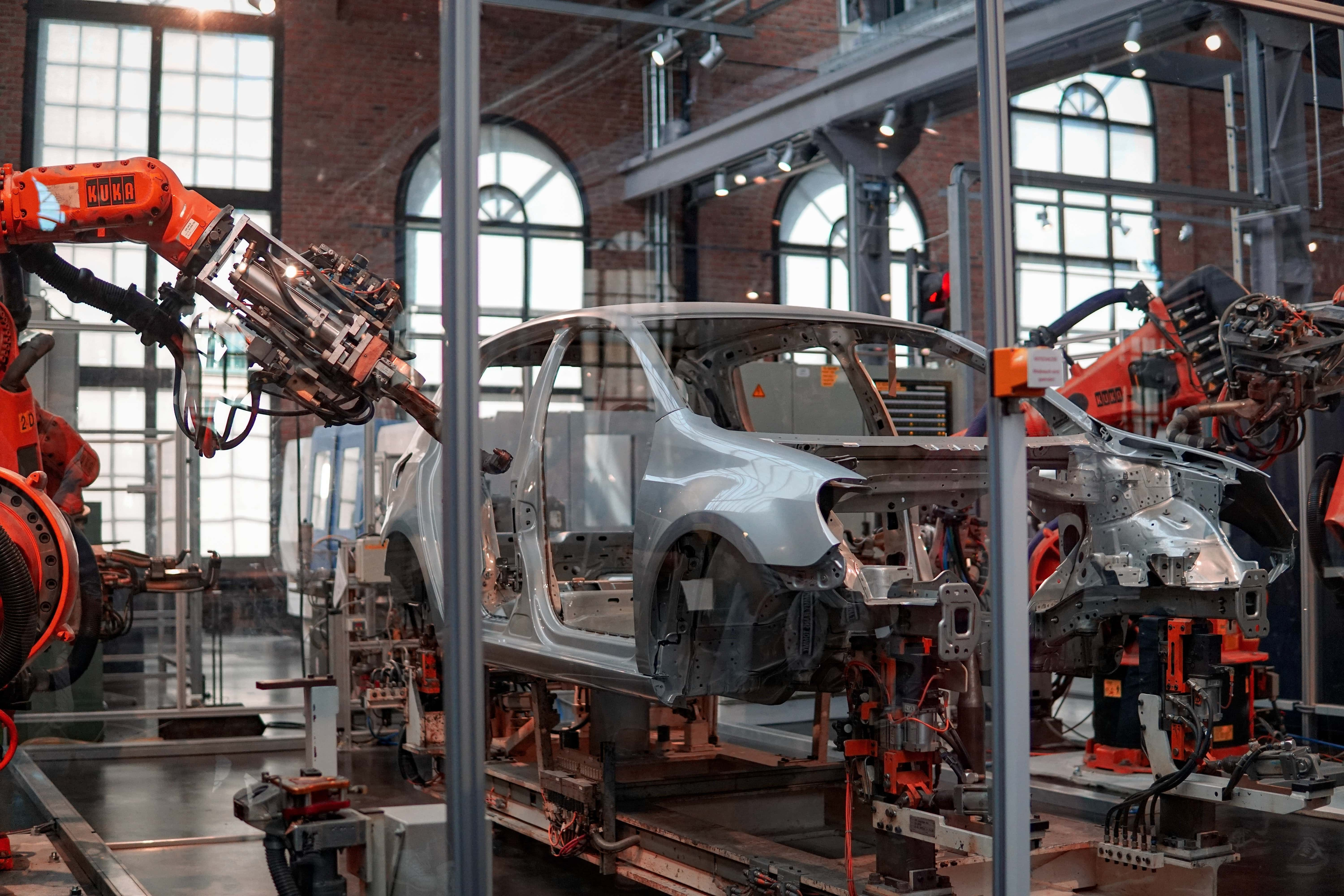 Image of a car being put together in a warehouse