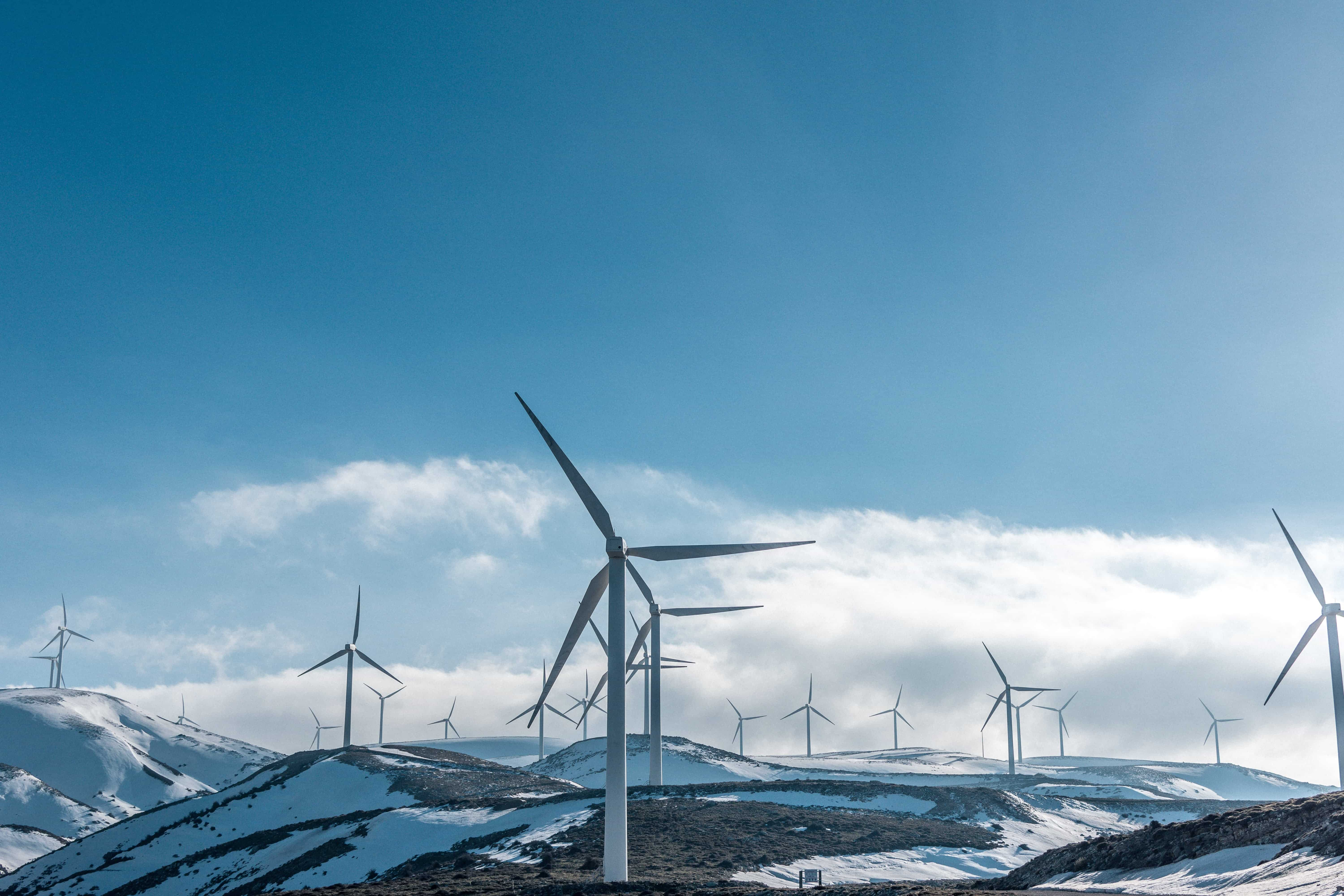 image of windmills over mountains