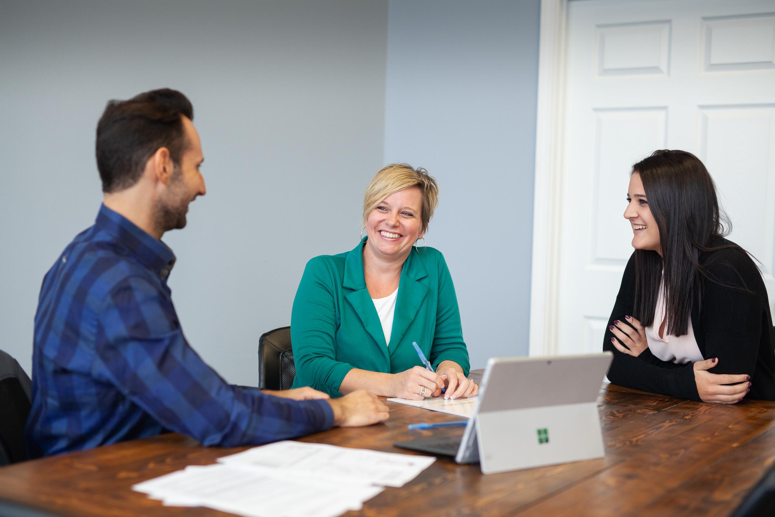 Listing Leader team members in a meeting