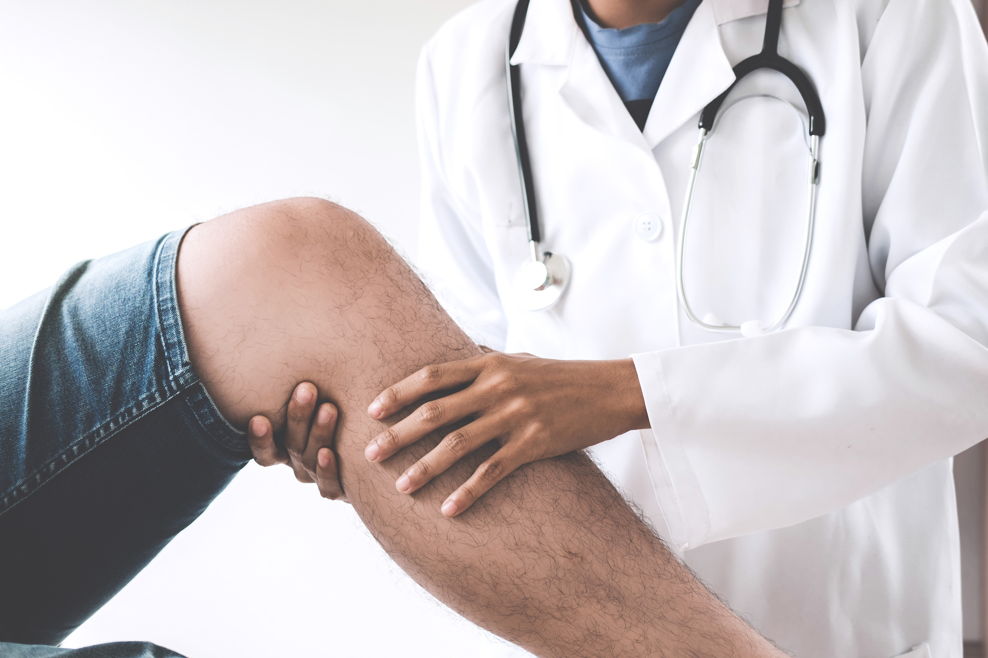 Doctor evaluating knee