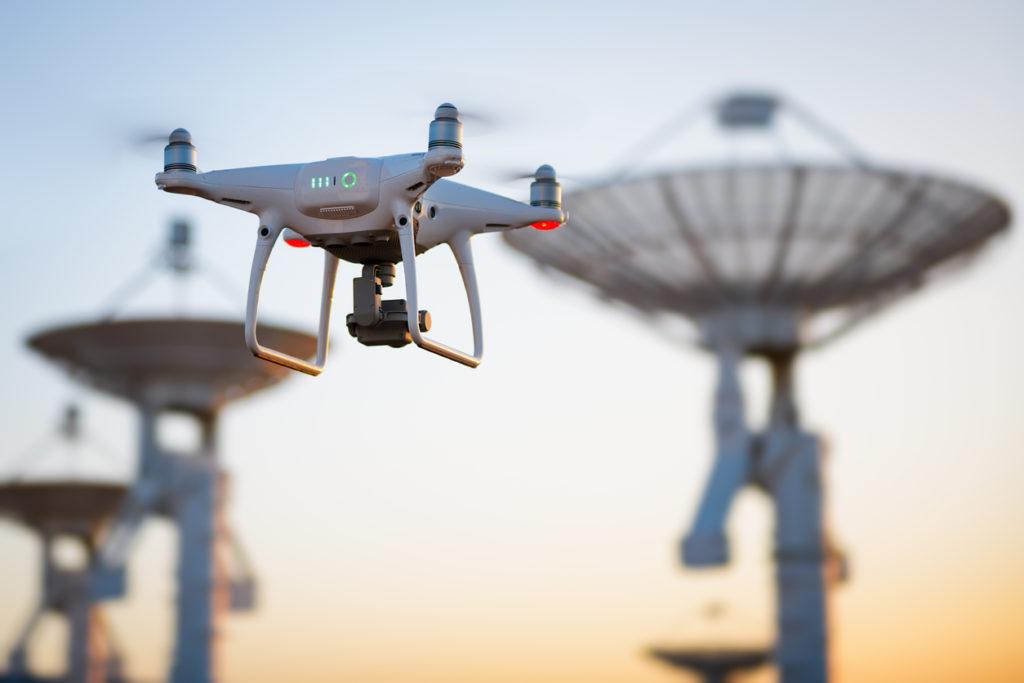 Drone flying next to radio antennas