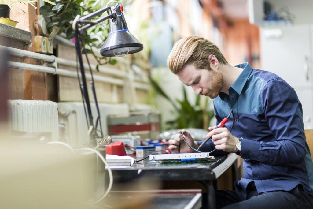 man working on computer board