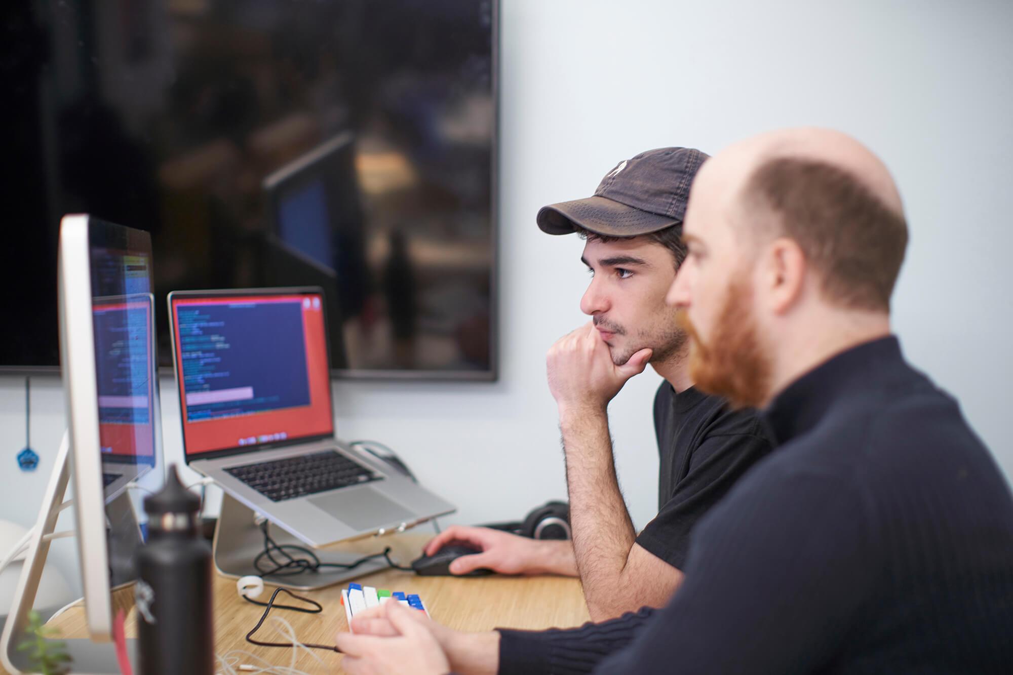 Two members of the Hologram engineering team pair programming in the Hologram office