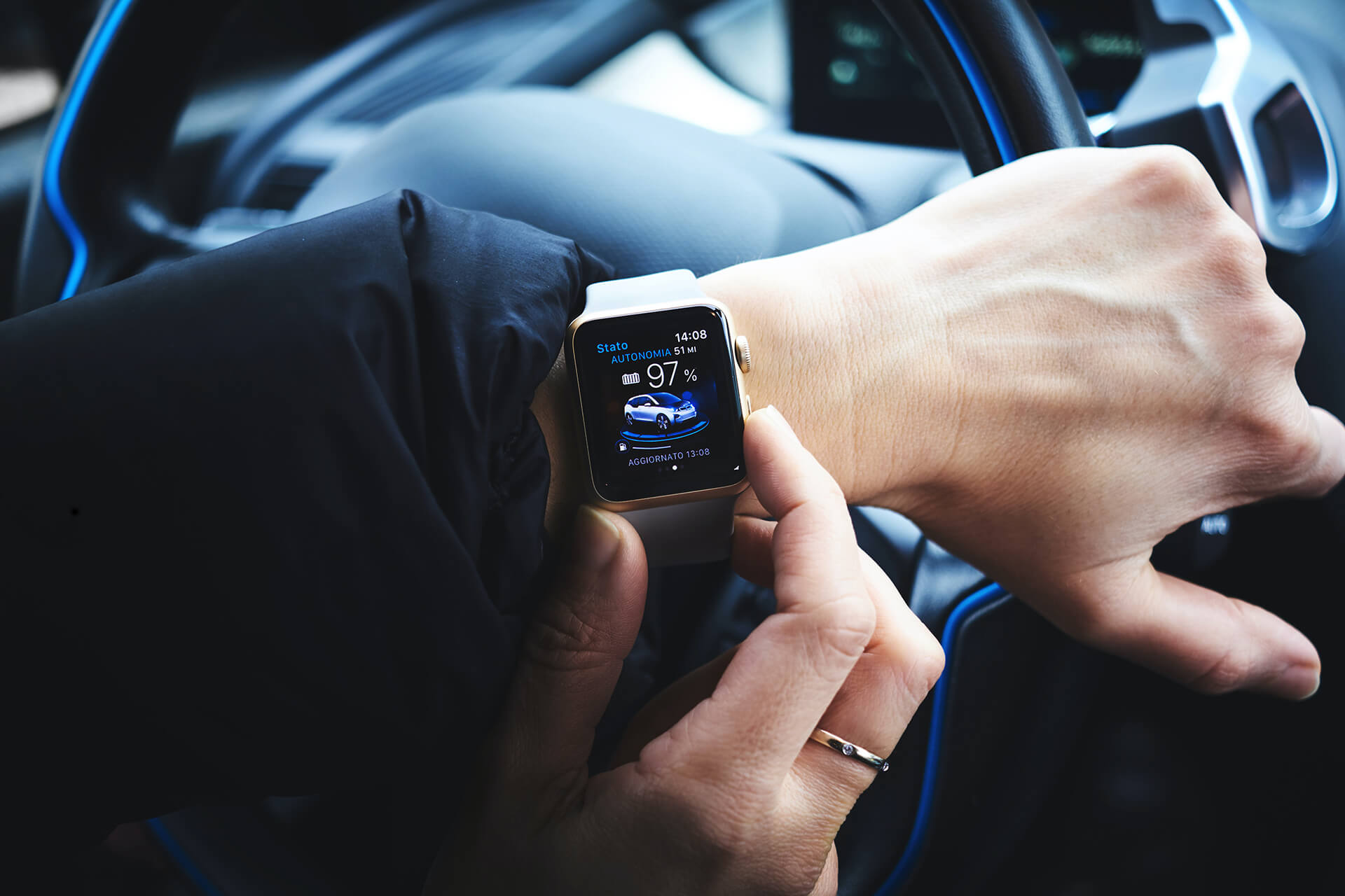 A person controls a smart car via their smart watch app