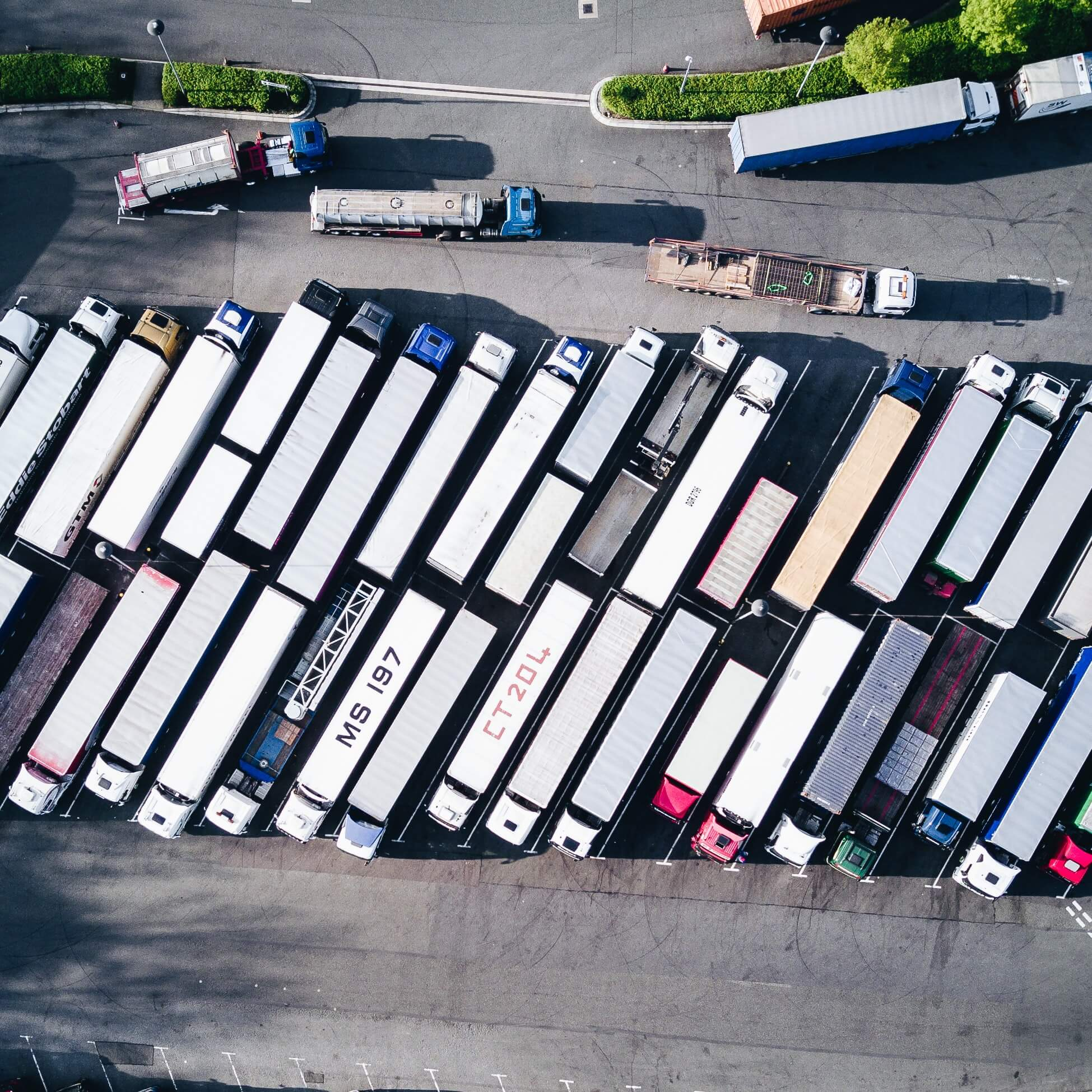 Aerial view of multiple truck fleets