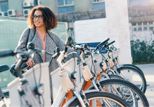 Woman standing by an electric bike station