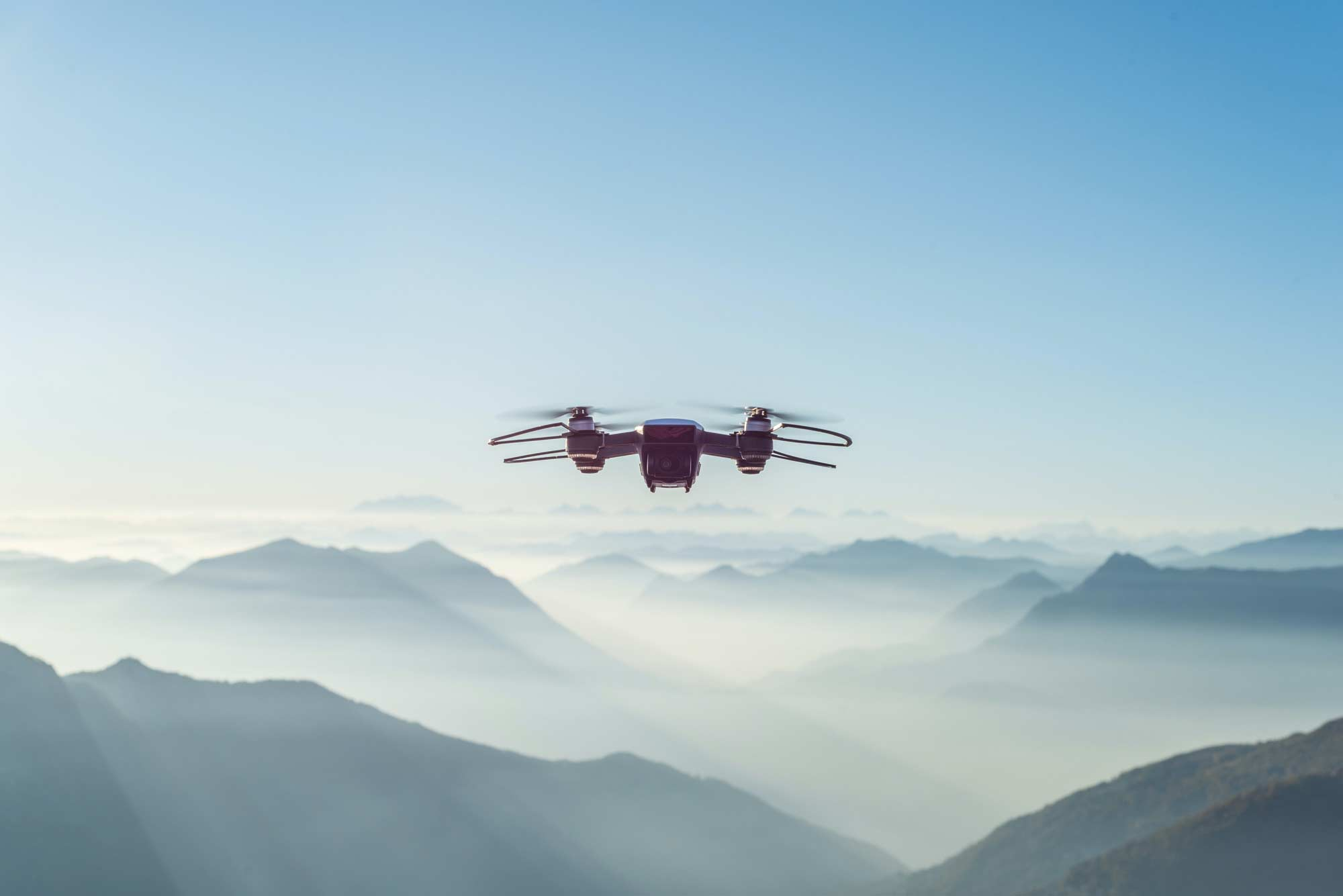 Drone flying above a mountain range