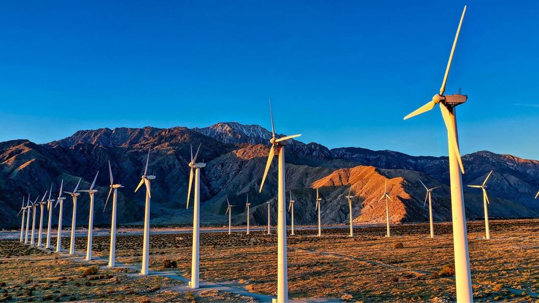 Multiple wind turbines in a vast field