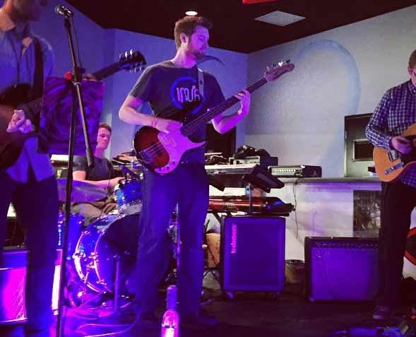 Hologramer Pat Hogan our resident rockstar playing bass