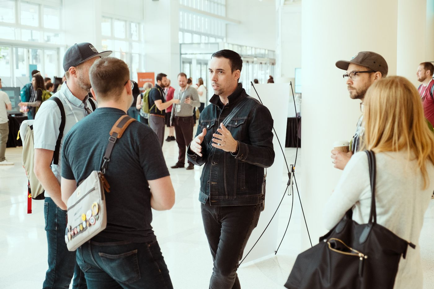 designers having conversation at front conference