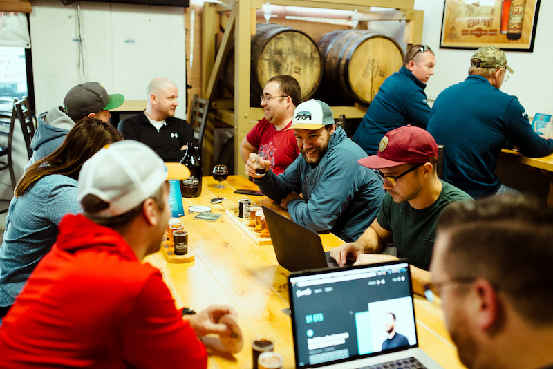 group working while tasting beer