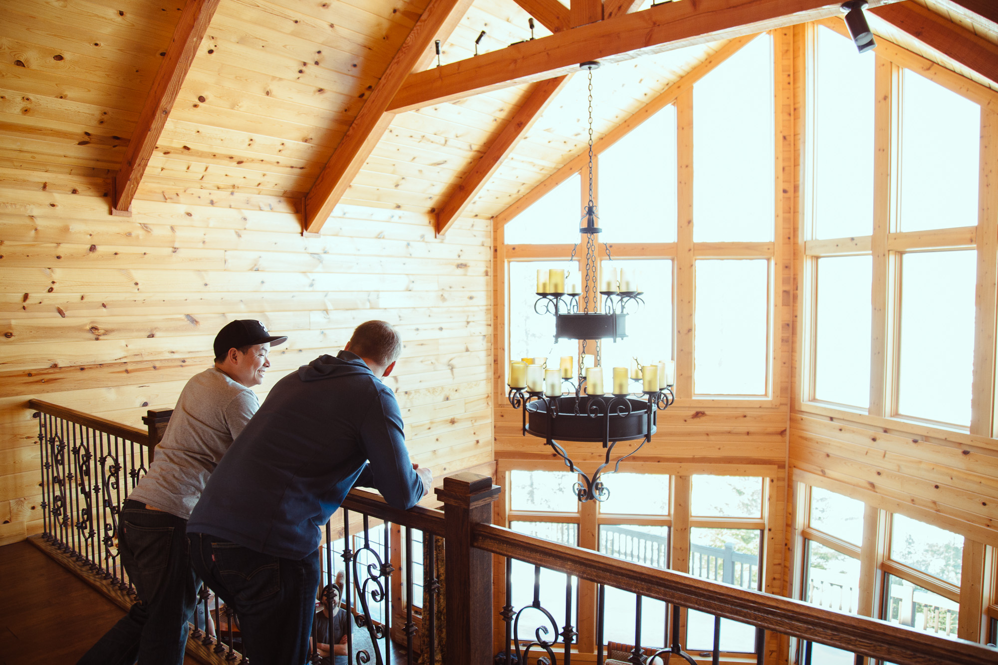 People chatting inside log cabin
